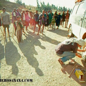 Natives surrounding the 4wd van of Around the World in 10 Years at an Ethiopian road